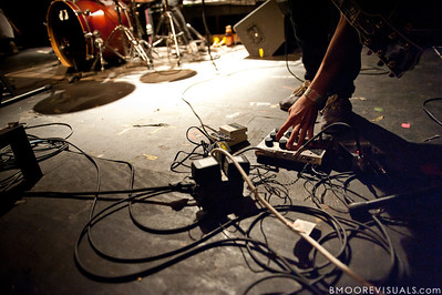 Ted Feldman of Bear Hands makes an adjustment during the band's performance on May 2, 2010 at State Theatre in St. Petersburg, Florida