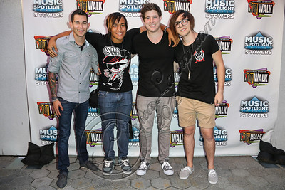 UNIVERSAL CITY, CA - AUGUST 31:  Drummer Eric Flores, bassist Trey Wilson, vocalist Justin Page, and guitarist Taylor Fiore of All Day Everyday arrive at Universal CityWalk's free music spotlight series at 5 Towers Outdoor Concert Arena on August 31, 2012 in Universal City, California.  (Photo by Chelsea Lauren/WireImage)
