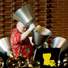 Scott Barker gives a full body performance on the largest handbells, several photos are necessary to show him in action.