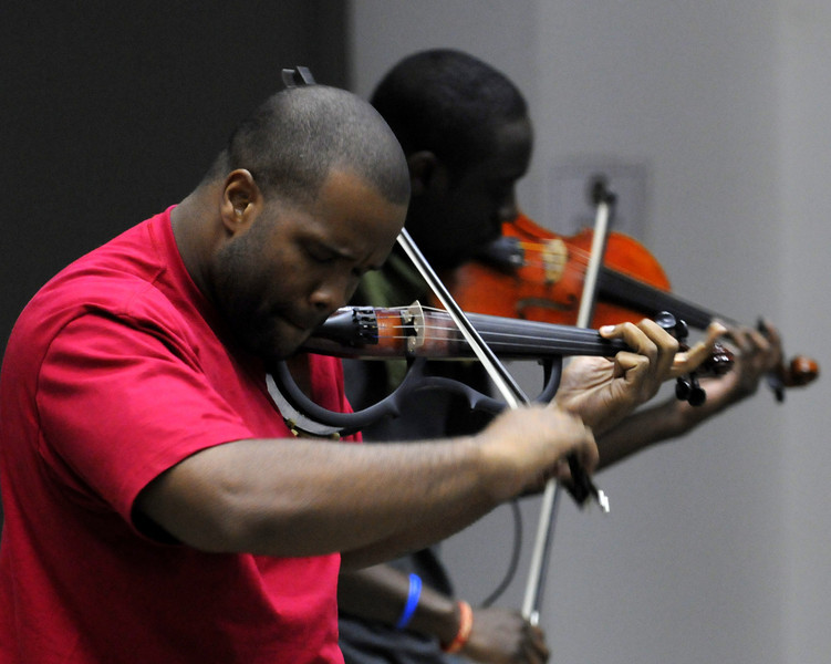 Black Violin at FOB Union III, Baghdad, Iraq, June 20, 2011. © Brandon Lingle
