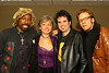 Before the show, members of the band share a lighthearted moment with Carlean Moser, owner of Bless Your Heart Music.