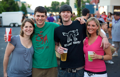 Allie and Ryan Wood of Milford with Eric Kurtz of Downtown and Jamie Hoff of Newton at Riverbend for Blink182 on August 13, 2009