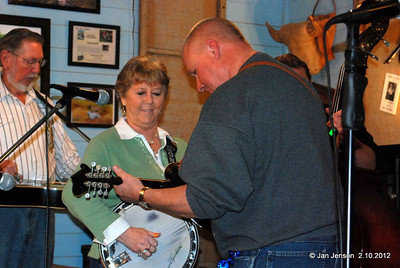 Jarvis Knight (dobro), Mona Jo Griffin (banjo) and Randy Whitley (guitar) jamming with the Dueling Banjos song.