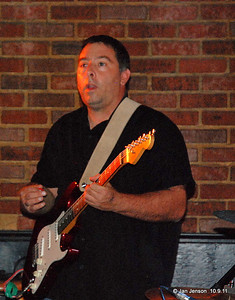 """Shuggie Brown Band """"Vicious"""" Vic Vermiglio -  (Guitar) Born and raised on the mean streets of 1980's Detroit (or the middle class suburbs), VVV fought and clawed his way through his formative years eventually winding up in the School of Hard Knocks (Wayne State University) when he somberly studied music with laser like focus (for 1 semester) until his skills were honed and sharpened to a razor sharp edge (he knew E, A & B).  It didn't take long until he outgrew the confines of the Midwest and headed out west with his band Electric Koolaid to the musical mecca of Southern California where's he's pretty sure he did lots of great and creative things (he can't remember anything from those years).   Then one morning he woke up, it was 1998 and he was in Charlotte, NC playing the blues, most notably with a band by the name of Willie's Heatstroke that eventually aquired quite a following (some sweaty fat guy and girl that smelled like chowder)   WH eventially ran their course and VVV wandered around aimlessly for a few years until the Shuggie brothers pulled up along side him in an unmarked black van and offered him some candy......(In actuality he just showed up at the Shuggie Shack one Sunday afternoon, we fed him and he stayed)."""