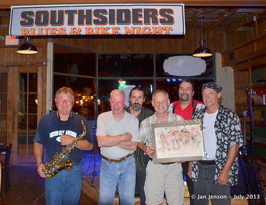 "The Mighty RhythmBusters with Chuck Calhoun and his drawing of the band - July 17, 2013  Roger Kolfta (sax), Martin Gaffney (drums), David ""Deacon""Strube (harmonica/keyboard/vocals), Chuck Calhoun (artist), Richard Strube (guitar/vocals),   and Keith Cash (bass/vocals) - The Mighty RhythmBusters."