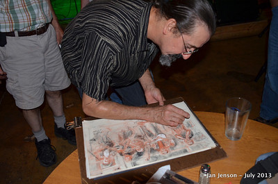 Martin Strube signs Chuck Calhoun's drawing
