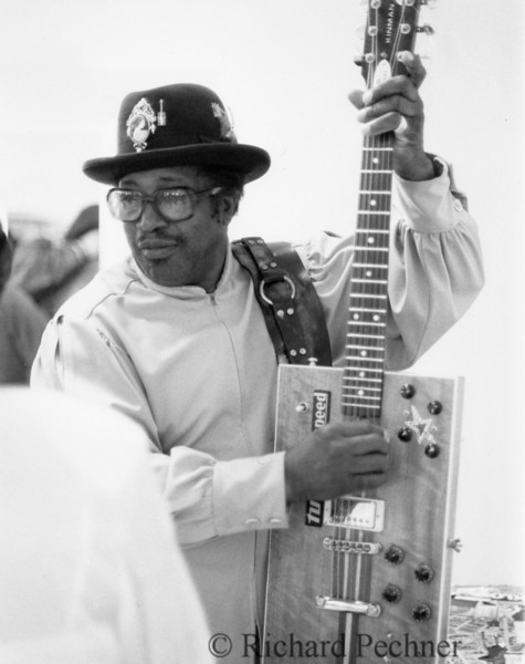 Bo Diddley tuning up in his dressing room before the Bammies, 3/15/1986