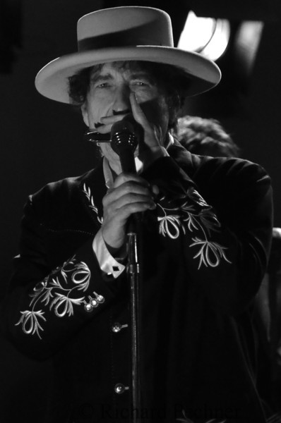 """Dylan playing harmonica on """"Blowin in The Wind"""" encore song of the set.  This image ran in the Maui News,  1/4 size , front page"""