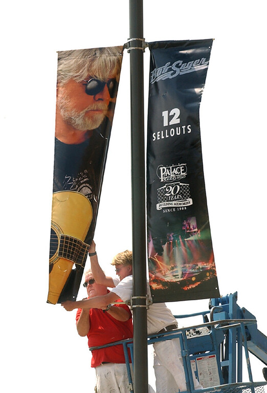 . Palace employees Glenn Bergman, left, and Greg Baugh hang a Bob Seger banner out side the Palace of Auburn Hills.  The Palace is hanging 12 commemorative banners of artists who have posted the most sold out shows there.  It\'s part of 20th anniversary celebration.   The Oakland Press/TIM THOMPSON