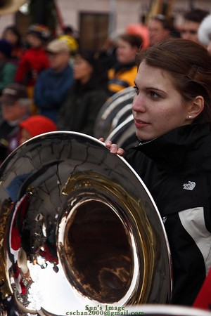 A Sousaphone player is waiting to play next song.