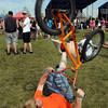 BE0530BSTOCK18<br /> Ian Crockett, 17, plays with his bicycle while laying on the ground during Thursday's Broomstock 2010 at the Broomfield County Commons. <br /> May 27, 2010<br /> Staff photo/ David R. Jennings