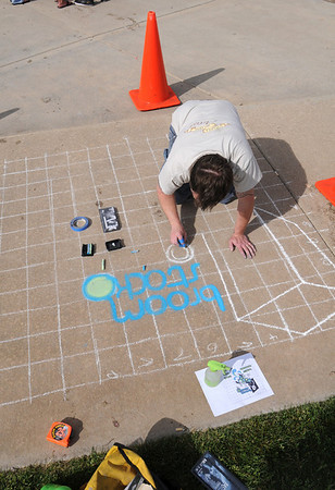 BE0530BSTOCK22<br /> Chalk artist ERic Matelski creats a drawing of the Broomstock 2010 poster during Thursday's Broomstock 2010 at the Broomfield County Commons. <br /> May 27, 2010<br /> Staff photo/ David R. Jennings