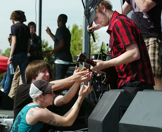 BE0530BSTOCK20<br /> Fans encourage the perfomance of guiatarist Kyle Coberly with Faces of Radio during Thursday's Broomstock 2010 at the Broomfield County Commons. <br /> May 27, 2010<br /> Staff photo/ David R. Jennings