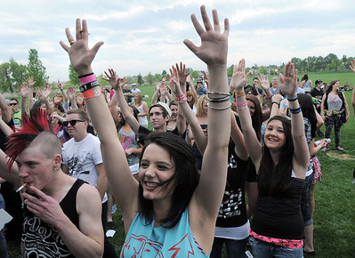 Samantha Haedrich, 19, raise her arms while singing to the music of 'Calibrate Me' during Broomstock at the Broomfield County Commons Park on Thursday.  May 26, 2011 staff photo/David R. Jennings