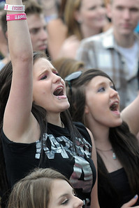 Brandi Holdridge, 20, left, and Nikki Rice, 17, sing and cheer during the performance of 'Be Brave' at Broomstock at the Broomfield County Commons Park on Thursday. May 26, 2011 staff photo/David R. Jennings