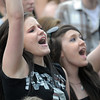 Brandi Holdridge, 20, left, and Nikki Rice, 17, sing and cheer during the performance of 'Be Brave' at Broomstock at the Broomfield County Commons Park on Thursday.<br /> May 26, 2011<br /> staff photo/David R. Jennings