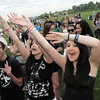 Brandi Holdridge, 20, left, cheers along side her friend Nikki Rice, 17, to the music of 'Calibrate Me' during Broomstock at the Broomfield County Commons Park on Thursday.<br /> May 26, 2011<br /> staff photo/David R. Jennings