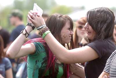 Heather Dungan, 17, dances with Jennifer Jelinski, 18, during Broomstock at the Broomfield County Commons Park on Thursday. May 26, 2011 staff photo/David R. Jennings