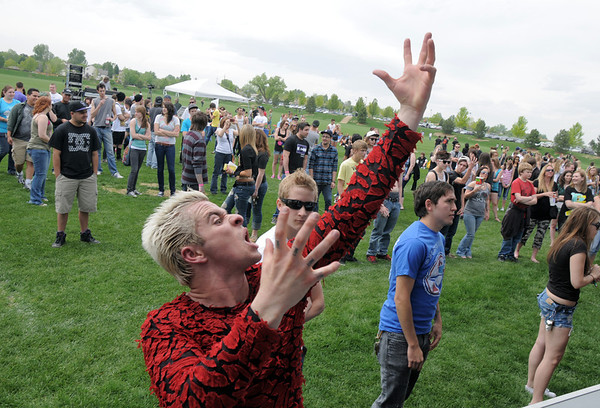 Carter James, 23, dances to the music of bands playing at Broomstock at the Broomfield County Commons Park on Thursday.<br /> May 26, 2011<br /> staff photo/David R. Jennings