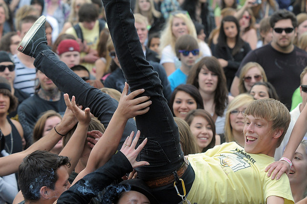 A fan is crowd surfed during Broomstock at the Broomfield County Commons Park on Thursday.<br /> May 26, 2011<br /> staff photo/David R. Jennings