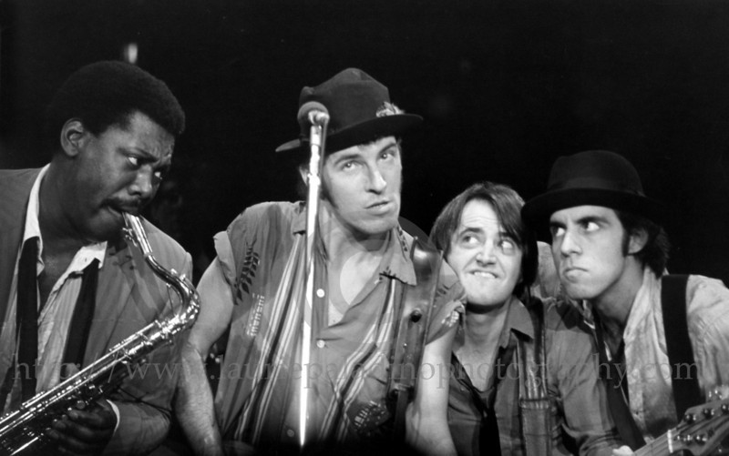 Bruce SprinsteenEStreetBand_lp_121181_1001<br /> Bruce Springsteen and the E Street band photographed live in concert performance 12/11/1981 during The River Tour by Laurie Paladino. Pictured left to right are Clarence Clemmons, Bruce Springsteen, Gary Tallent and Miami Steve Van Zandt.<br /> I'm sure every photographer has a personal favorite photograph. This is mine. It was a shot I grabbed from the audience and if I remember correctly I had a converter on the camera lens to double the focal length.<br />  Although the shot is not in perfect focus the spirit of the moment was captured during The River Tour in 1981.<br />  I recall a friend of Steve Van Zandt's requested a copy of the photo for Steve after seeing it published in a few rock magazines. Although I provided a print it never helped me get any photo passes for future performances, unfortunately!<br />  I've always thought of this shot as my iconic rock photo. A framed hand-tinted version hangs on the wall above my Mac.<br /> All Rights Reserved. <br /> No usage of any kind without written permission of Laurie Paladino.<br /> Licensing inquires: laurie@lauriepaladinophotography.com