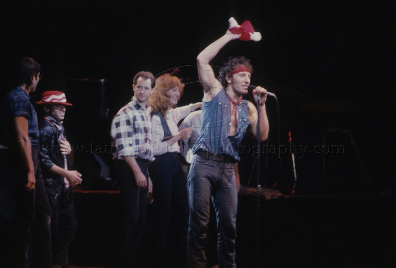 """BruceSpringsteen_lp_1015<br /> Bruce Springsteen and The E Street Band perform live in concert. Bruce says goodnight to the audience after performing his holiday classic """"Santa Claus is Coming to Town.""""<br /> Photo ©Laurie Paladino"""