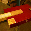 Closeup of box with fingerboard, neck and tailpiece.