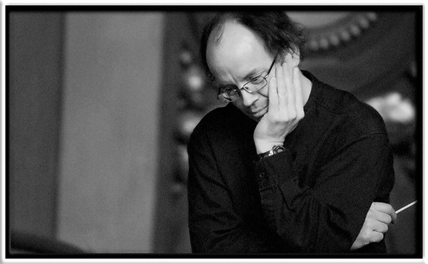 Mark Latham  Looking over the score of Ives's The Unanswered Question  Mark Latham, conductor  Campus Symphony Orchestra (W2006) University of Michigan, Ann Arbor  15-MAR-2006