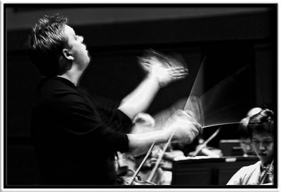 Rob  Rob rehearses Rimsky Korsakov's Russian Easter Overture to end the CSO dress rehearsal at Hill  Campus Symphony Orchestra (W2006) Robert Boardman, conductor  Hill Auditorium University of Michigan, Ann Arbor  15-MAR-2006