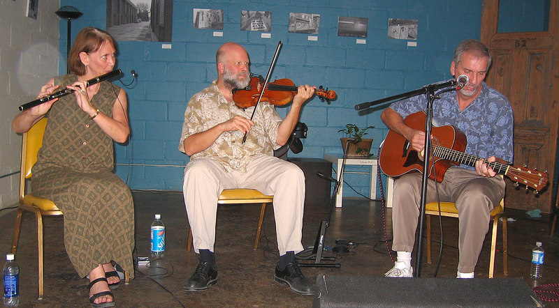 """<a href=""""http://home.bellsouth.net/p/pwp-kylebrack"""">Kylebrack</a> is a local Triangle, NC-area band playing traditonal Irish music. The band consists of Alison Arnold (wooden flute), Paul Fackler (fiddle), and Donald Lively (guitar), and they specialize in lyric music of East Galway and Clare. They are named, according to their website, """"after a small town in East Galway, Ireland, that has been home to many fine musicians, including a number of noted flute players"""". We enjoyed seeing them - I was not surprised to see that they perform at contra dances."""