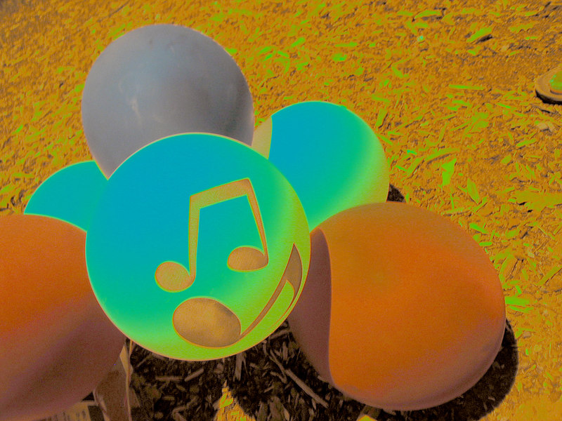 Music festival balloons on ground at night [solarized and lightened]