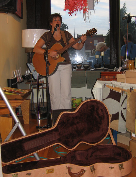 """We only caught the last two songs of <a href=""""http://lynkoonce.com/"""">Lyn Koonce</a>, but we enjoyed her gorgeous voice and soft guitar accompaniment. I believe that she is Greensboro-based and teaches voice. I hope that we get to hear her elegant and calming voice singing at another venue soon."""