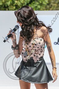 LOS ANGELES, CA - AUGUST 11:  Singer Cher Lloyd performs at Teen Vogue's National Shopping Holiday back-to-school saturday launch at The Grove on August 11, 2012 in Los Angeles, California.  (Photo by Chelsea Lauren/WireImage)