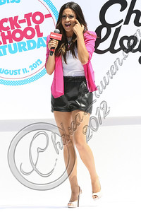 LOS ANGELES, CA - AUGUST 11:  Actress Shay Mitchell speaks at Teen Vogue's National Shopping Holiday back-to-school saturday launch at The Grove on August 11, 2012 in Los Angeles, California.  (Photo by Chelsea Lauren/WireImage)