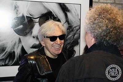 Chris Stein sharing a laugh with Bob Gruen