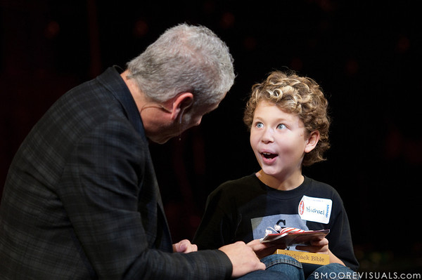 Louie Giglio presents a Christmas gift to a young boy from the audience on December 3, 2009 at Countryside Christian Center in Clearwater, Florida