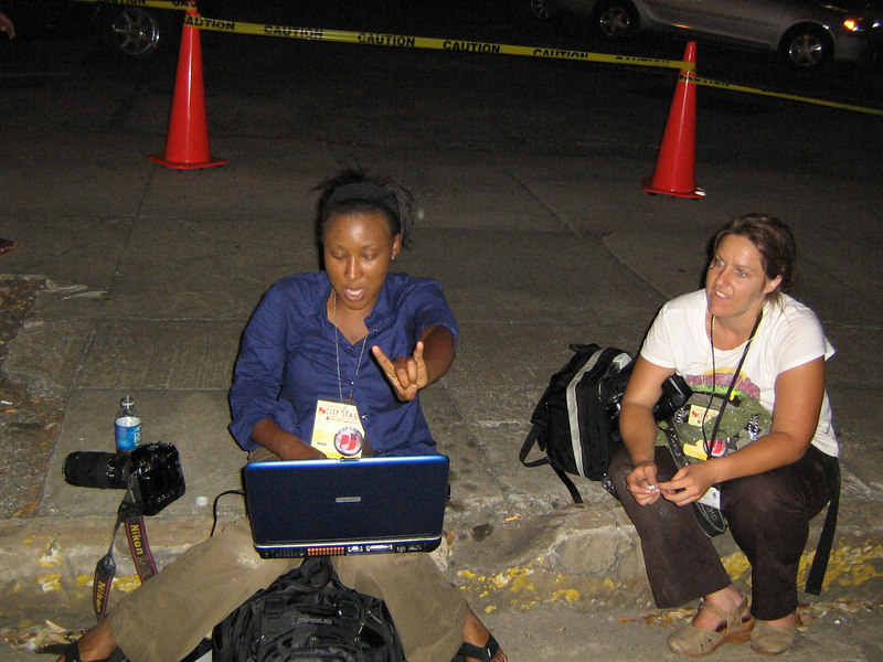 Our pal Tamika, left, who's filing photos on deadline for the Birmingham News -- her swanky office is the sidewalk behind the mypeople.com Stage, a mere block from the newsroom.