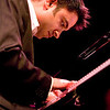 "Vijay Iyer, Jazz Pianist<br /> Photo by Hans Speekenbrink<br /> <br /> By now, there can be no doubt that pianist-composer Iyer stands among the most daringly original jazz artists of the under-40 generation – Howard Reich the Chicago Tribune<br /> <br /> The American-born son of Indian immigrants, Vijay Iyer (pronounced ""VID-jay EYE-yer"") is a self-taught creative musician grounded in American jazz and popular forms, and drawing from a wide range of Western and non-Western traditions. He was described by The Village Voice as ""the most commanding pianist and composer to emerge in recent years,"" by The New Yorker as one of ""today's most important pianists… extravagantly gifted,"" and by the L.A. Weekly as ""a boundless and deeply important young star.""<br /> <br /> Most recently, in the Jazz Journalists Association Jazz Awards, Iyer was named the 2010 Musician of the Year, an honor previously given to Herbie Hancock, Ornette Coleman, Wayne Shorter, and Dave Holland.<br /> <br /> The breadth and depth of Iyer's recorded output defy any simple description. His music has covered so much ground at such a high level of acclaim that it is easy to forget that it all belongs to the same person. In August 2010 he releases Solo, his first solo piano album, covering an astonishing range in his most personal statement yet, on the German label ACT Music + Vision. Iyer's 2009 release, Historicity (ACT), a classic piano-trio set of surprising covers and originals rendered in his signature approach, became one of the most acclaimed jazz albums of the decade. It was chosen as the #1 Jazz Album of the Year by The New York Times, the Los Angeles Times, the Chicago Tribune, the Detroit Metro Times, National Public Radio, PopMatters.com, the Village Voice Jazz Critics Poll, and the Downbeat International Critics Poll.<br /> <br /> Alongside these works sit several vastly different, equally important and groundbreaking collaborations. Among the best known are In What Language? (2004), Still Life with Commentator (2007), and the work-in-progress Holding it Down, three politically searing, stylistically omnivorous large-scale works created by Iyer and poet-performer Mike Ladd (""unfailingly imaginative and significant"" – JazzTimes; ""powerful narrative invention and ravishing trance-jazz… an eloquent tribute to the stubborn, regenerative powers of the human spirit"" – Rolling Stone). On another end of the spectrum, Your Life Flashes (2002), Simulated Progress (2005), and Door (2008) capture the innovations of the experimental collective Fieldwork (""phenomenal… incredible, challenging, and forward-thinking"" – All Music Guide). And last but not least, Raw Materials (2006, ""a total triumph from beginning to end"" – All About Jazz) documents ""one of the great partnerships in jazz"" (Chicago Tribune) – the duo of Iyer and Rudresh Mahanthappa. All of Iyer's albums have appeared on best-of-the-year lists in dozens of major media, ranging from JazzTimes, Jazzwise, Jazzman, Downbeat, and The Wire, to ArtForum, National Public Radio, The Utne Reader, The New Yorker, and The Village Voice."