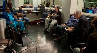 Henry Butler listening to Josh White Jr. and John Sebastian jamming while Pete Seeger and David Amram grab a bite with Adam Amram taking it all in.  That's Powhatan Swift Eagle in the mirror on the right behind Henry.