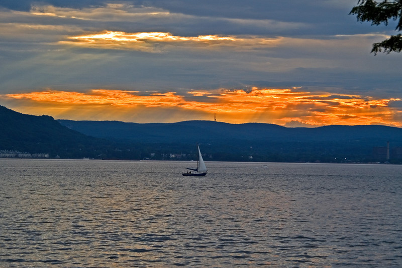 A wide river, a beautiful sunset and a boat to sail on. What more could one ask for?