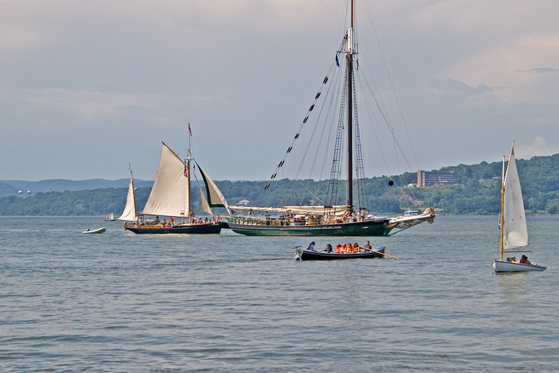 I just love this shot. Except for the big building on the other side,  and the Zodiac towed by the gaff rigged yawl, every other craft in this shot could have been seen in the mid to late 1900's, up to and including the sprit rigged sailing canoe way off in the distance just to the left of the yawl.