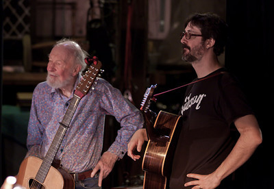 Pete Seeger and Tao Rodriquez wating for their sound check.