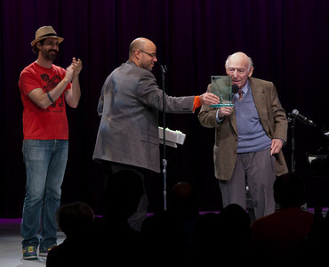 "Tao Seeger and Jeff Rumpf, Executive Director of Hudson River Sloop Clearwater presenting George Wein with the ""Power of Song"" award."