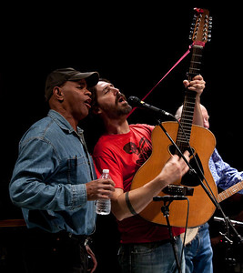 Guy Davis and Tao Seeger rehearsing for the finale with Pete Seeger in the background.