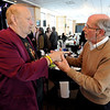 "Barry Fey, left, and Harry Tuft, greet each other before the ceremony honoring them.<br /> Barry Fey and Harry Tuft were inducted into the Colorado Music Hall of Fame during a ceremony at the Stadium Club at Folsom Field on the CU campus on Sunday.<br /> For a video and more photos the event, go to  <a href=""http://www.dailycamera.com"">http://www.dailycamera.com</a>.<br /> Cliff Grassmick / February 12, 2012"