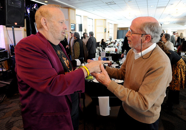 """Barry Fey, left, and Harry Tuft, greet each other before the ceremony honoring them.<br /> Barry Fey and Harry Tuft were inducted into the Colorado Music Hall of Fame during a ceremony at the Stadium Club at Folsom Field on the CU campus on Sunday.<br /> For a video and more photos the event, go to  <a href=""""http://www.dailycamera.com"""">http://www.dailycamera.com</a>.<br /> Cliff Grassmick / February 12, 2012"""