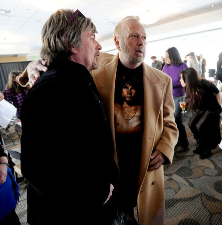 "Jock Barkley, left, formerly of the Boulder-based group, Firefall, stops to talk to Barry Fey.<br /> Barry Fey and Harry Tuft were inducted into the Colorado Music Hall of Fame during a ceremony at the Stadium Club at Folsom Field on the CU campus on Sunday.<br /> For a video and more photos the event, go to  <a href=""http://www.dailycamera.com"">http://www.dailycamera.com</a>.<br /> Cliff Grassmick / February 12, 2012"