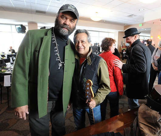 "Well-known musicians, Otis Taylor, left, and Kenny Passarelli, stop for a photo before the ceremony.<br /> Barry Fey and Harry Tuft were inducted into the Colorado Music Hall of Fame during a ceremony at the Stadium Club at Folsom Field on the CU campus on Sunday.<br /> For a video and more photos the event, go to  <a href=""http://www.dailycamera.com"">http://www.dailycamera.com</a>.<br /> Cliff Grassmick / February 12, 2012"