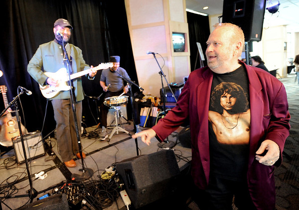 """Barry Fey, right, acknowledges Otis Taylor and Kenny Passarelli, not pictured.<br /> Barry Fey and Harry Tuft were inducted into the Colorado Music Hall of Fame during a ceremony at the Stadium Club at Folsom Field on the CU campus on Sunday.<br /> For a video and more photos the event, go to  <a href=""""http://www.dailycamera.com"""">http://www.dailycamera.com</a>.<br /> Cliff Grassmick / February 12, 2012"""
