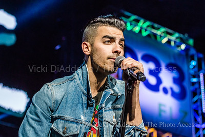 Joe Jonas of DNCE performing at 93.3 FLZ's iHeartRadio Jingle Ball on December 17, 2016 at Amalie Arena in Tampa, Florida.